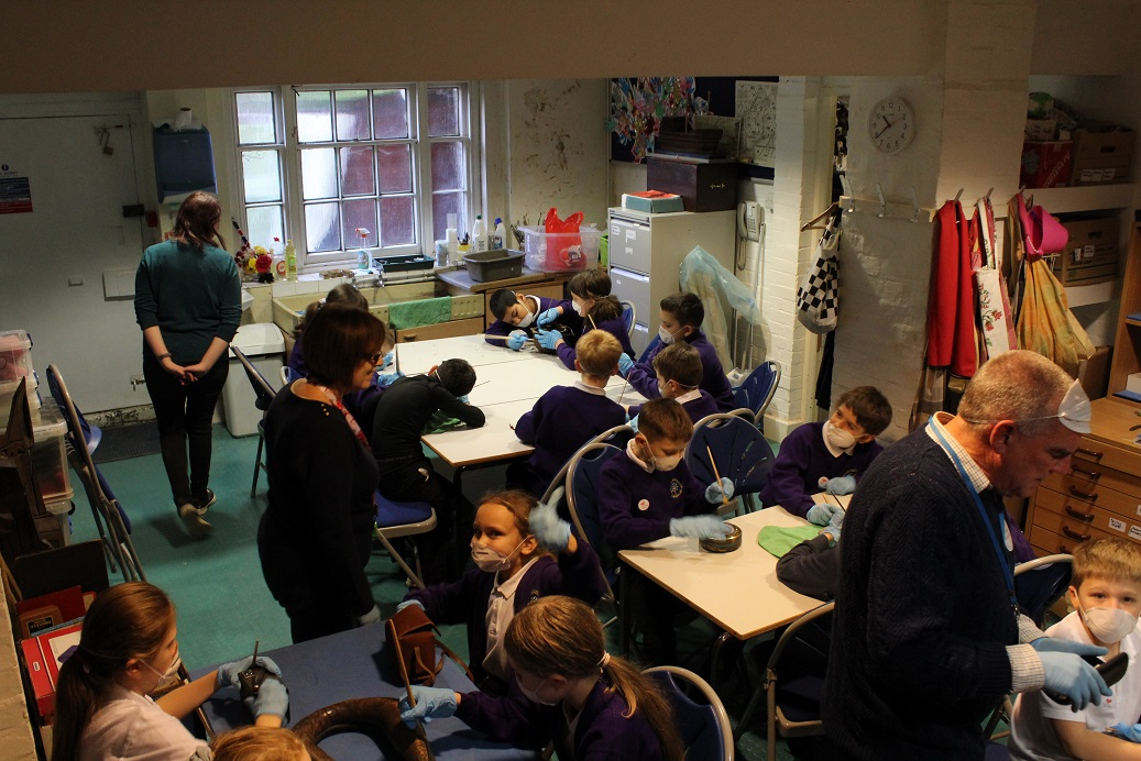 Schoolkids learn how to care for the past at Wisbech Museum